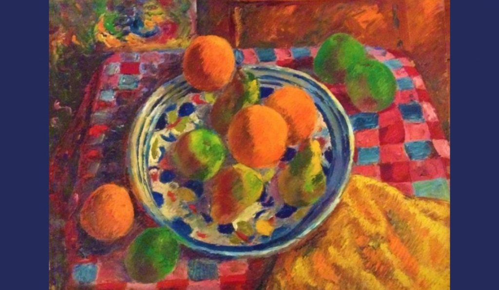 Still life oil painting of fruit on a colourful Spanish plate on a chequered cloth by Colin Moss