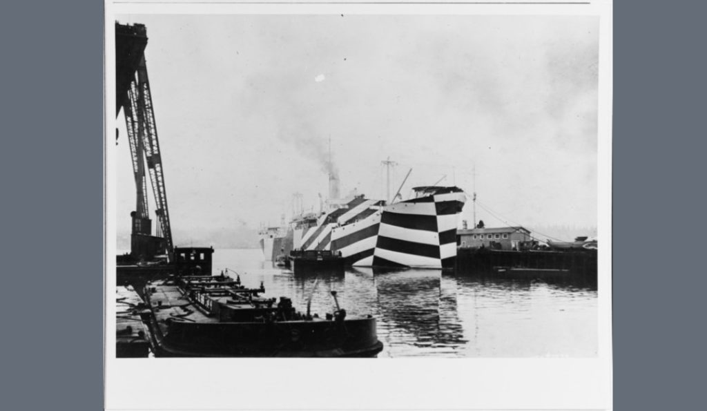 The ship has a dazzle camouflage scheme which distorts the appearance of her bow.